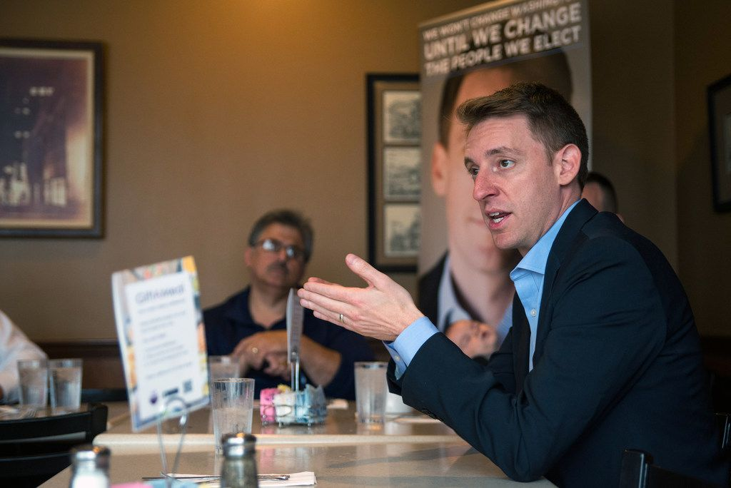 Jason Kander, an Army veteran, speaks during an event with military veterans in St. Louis on  Oct. 19, 2016. Kander dropped out of the Kansas City mayoral race on Oct. 2, 2018, saying he needed to focus on healing from post-traumatic stress disorder.