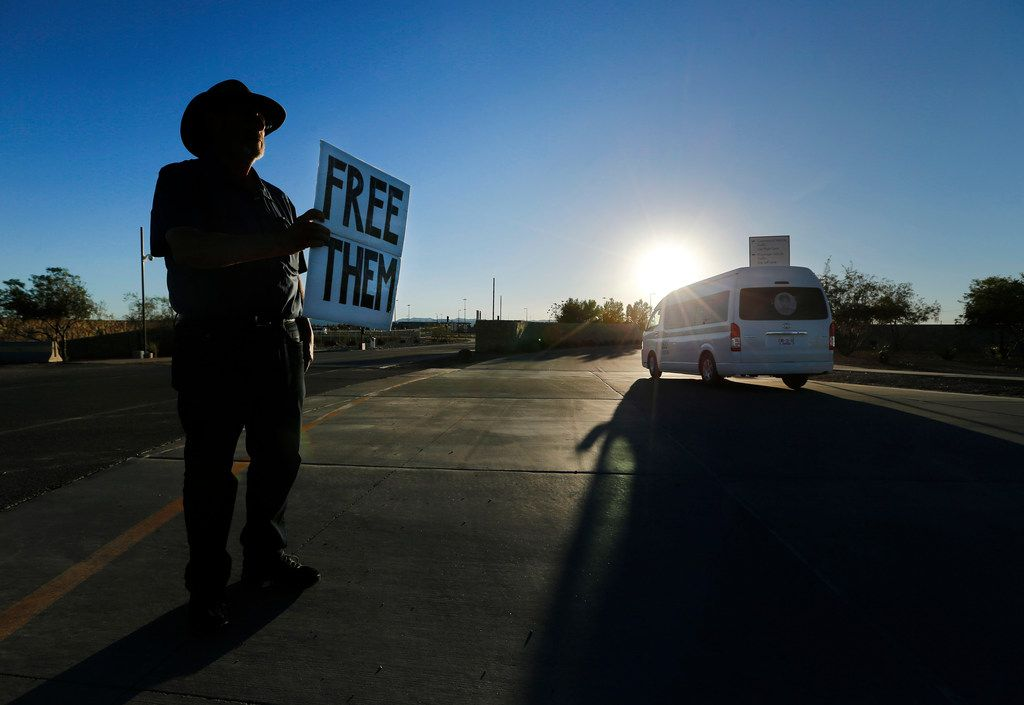 Joshua Rubin of Brooklyn, New York holds up signs to passing vehicles going over the border or to the Health and Human Services encampment or 'Tent City' adjacent to the Tornillo Port of Entry near Tornillo, Texas, Thursday, November 8, 2018. He kept vigil outside the main border gate for months.