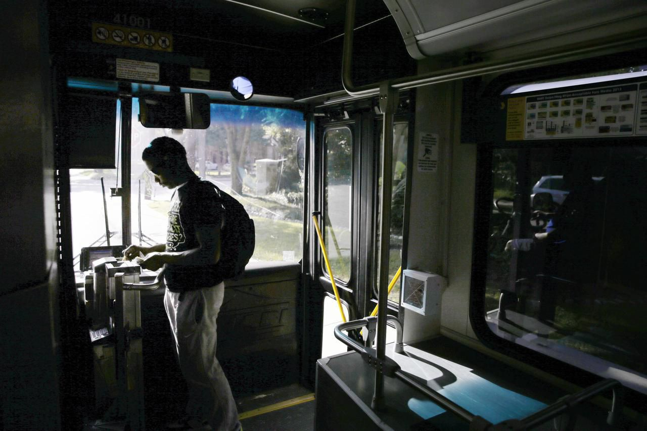"""Davonte Galbert boards a DART bus at Haverwood Lane and Pear Ridge Drive in Dallas on his way to visit a friend at Southern Methodist University. The route passes within an area deemed a """"transit desert"""" by researchers at the University of Texas at Austin."""