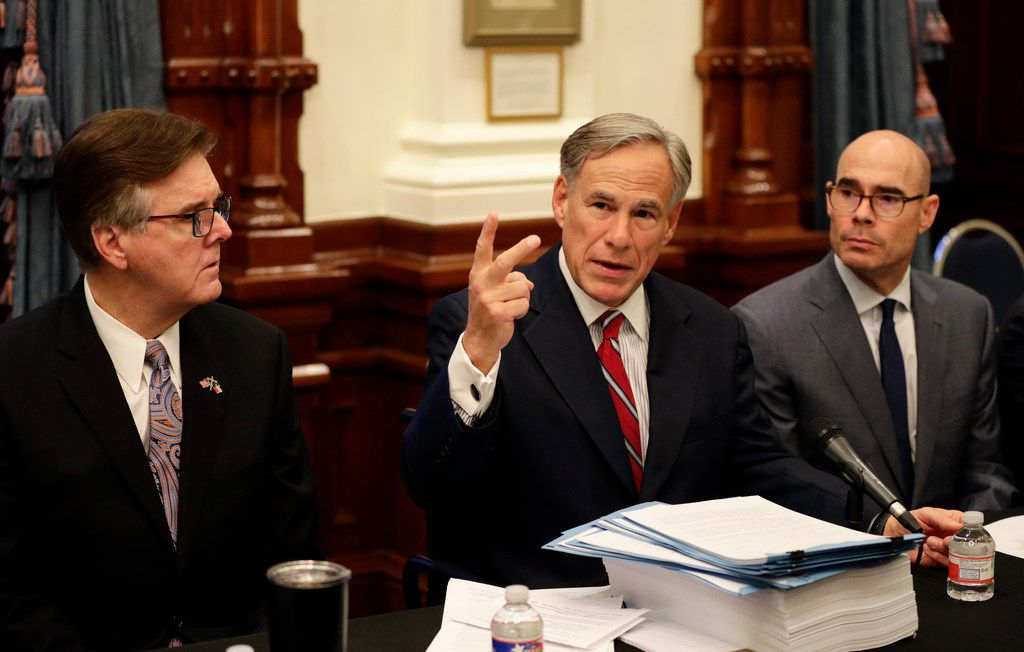 Texas Gov. Greg Abbott, center with Speaker of the House Dennis Bonnen, right, and Lt. Gov. Dan Patrick, left, makes opening statements during a roundtable discussion on Aug. 22, 2019, in Austin.