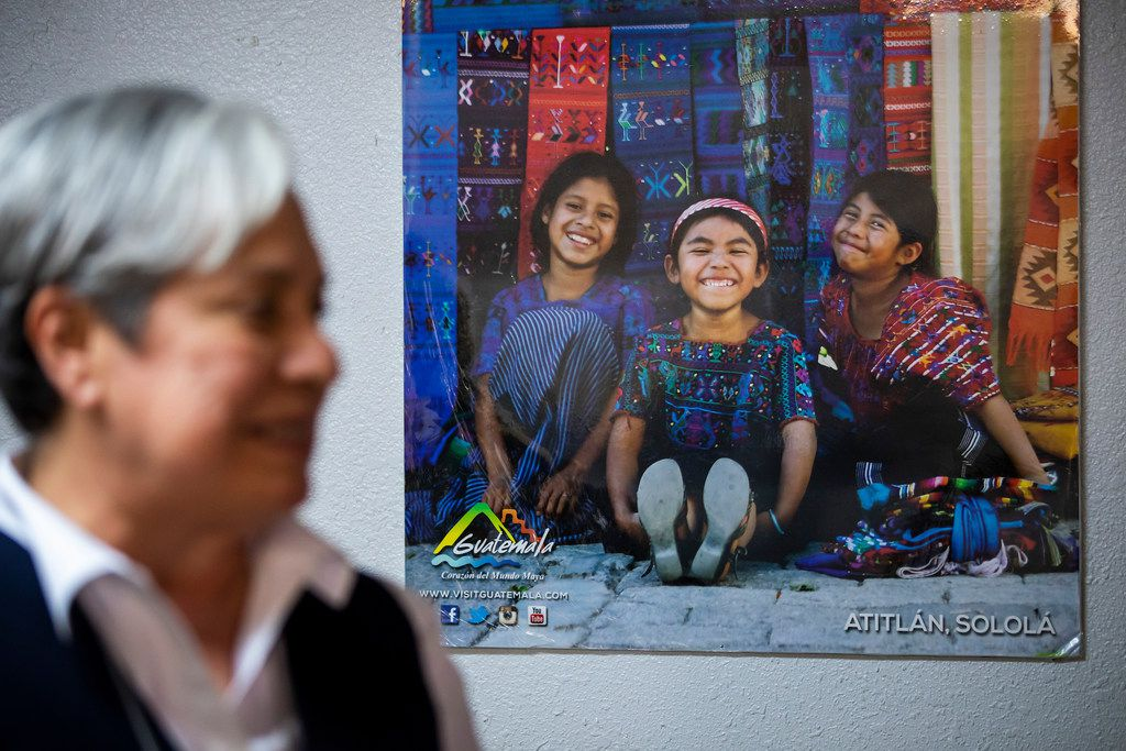 A poster showing children in Guatemala hangs behind Sister Norma Pimentel as she talks to media at the Catholic Charities RGV Humanitarian Respite Center on Tuesday, June 19, 2018, in McAllen.
