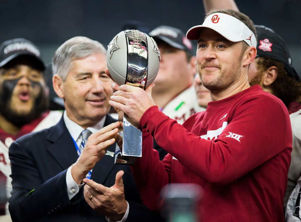 Oklahoma Sooners head coach Lincoln Riley receives the Big 12 Championship trophy after winning 39-27 over the Texas Longhorns on Saturday, December 1, 2018 at AT&T Stadium in Arlington, Texas. The Sooners won 39-27. (Ashley Landis/The Dallas Morning News)