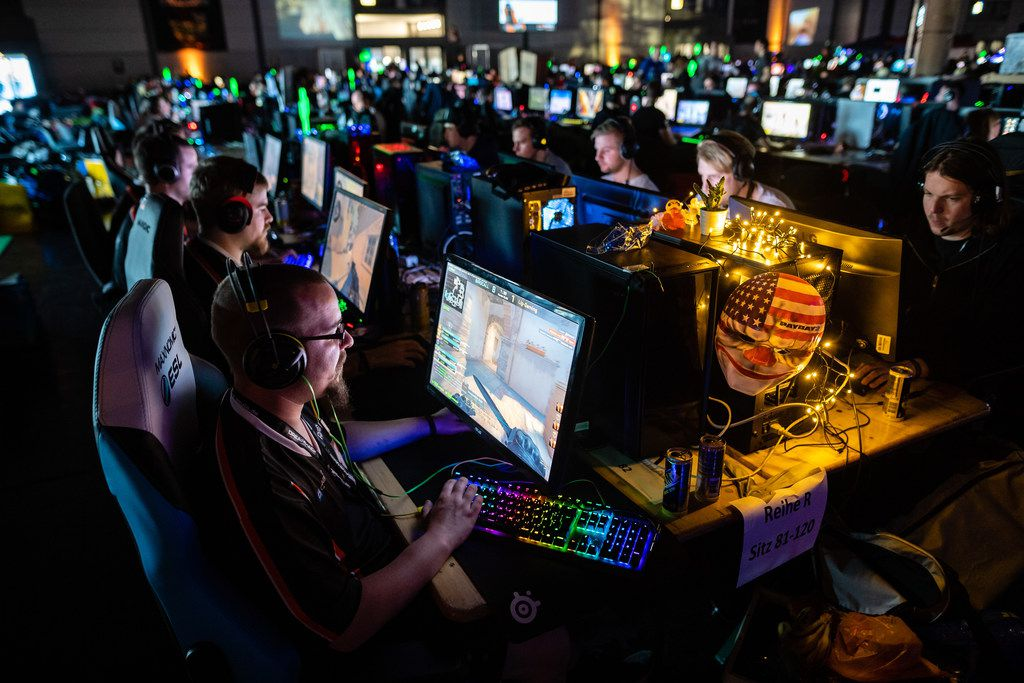 LEIPZIG, GERMANY - FEBRUARY 15: Participants sit at a computer monitor to play a video game at the 2019 DreamHack video gaming festival on February 15, 2019 in Leipzig, Germany. The three-day event brings together gaming enthusiasts, mainly from German-speaking countries, for events including eSports tournaments, cosplay contests and a LAN party with 1,500 participants.