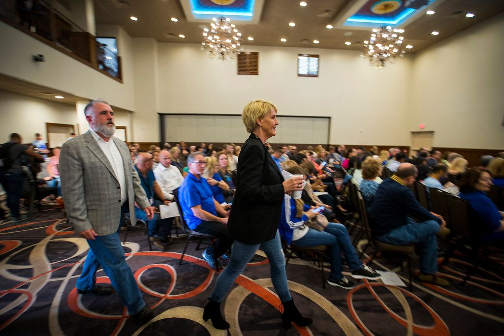 Environmental activist Erin Brockovich (center) and water consultant Bob Bowcock arrive for a town hall style meeting at Frisco Celebration Hall on Thursday.
