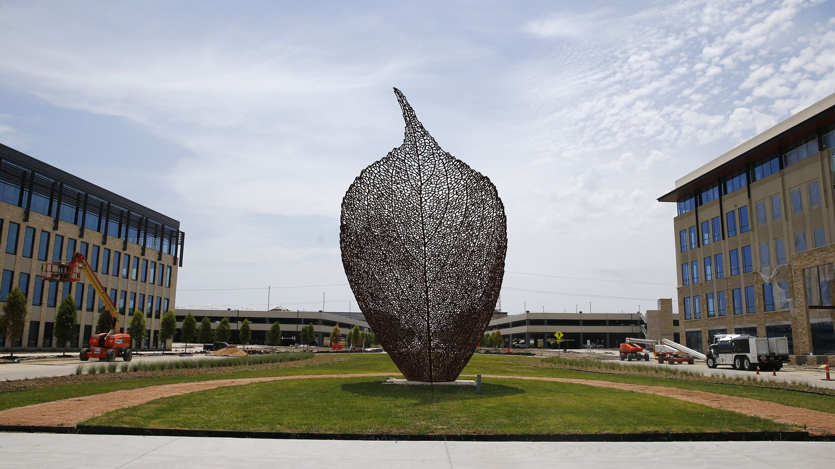 An art installation of a leaf at the Cypress Waters development. Brinker International is moving into the building on the left and Nokia just rented space in the office on the right.