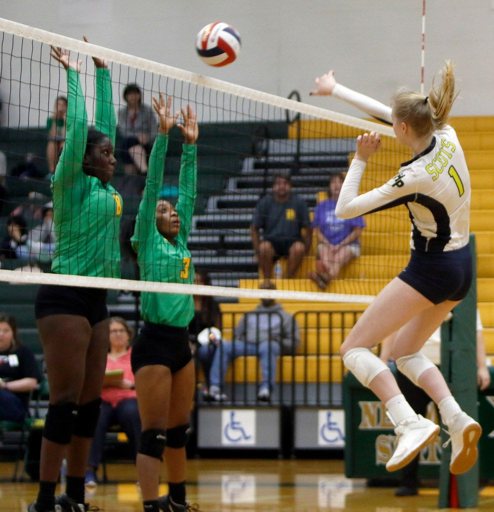 Highland Park's Avery Hellmuth (1) fires a winner past Carrollton Newman Smith defenders Na'Tay Robertson (3) and Taya Owens (8) during the second game of their match in which the Scots won in 3: 25-12, 25-17, 25-4. The two teams played their District 11-5A volleyball match at Carrollton Newman Smith High School in Carrollton on October 8, 2019. (Steve Hamm/ Special Contributor)