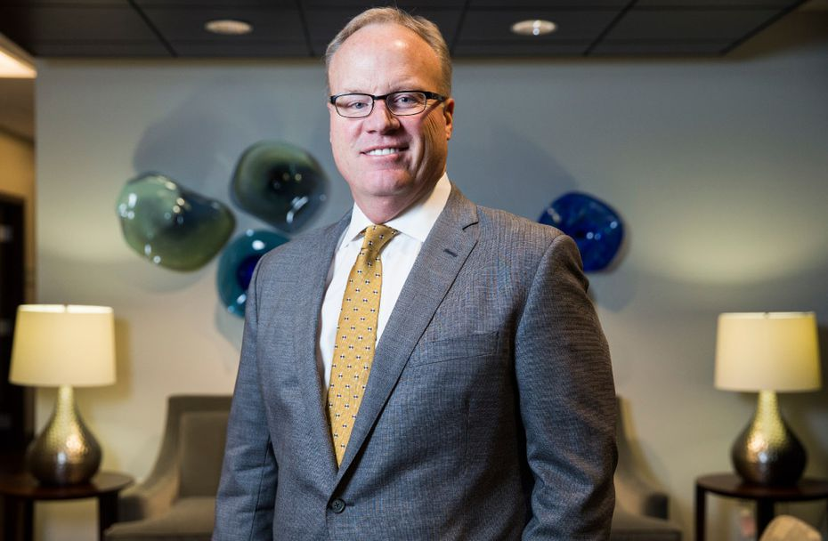 Jim Hinton, the CEO of Baylor Scott a& White Health, poses for a portrait in the lobby of their Dallas corporate offices in 2017. (Ashley Landis/The Dallas Morning News)