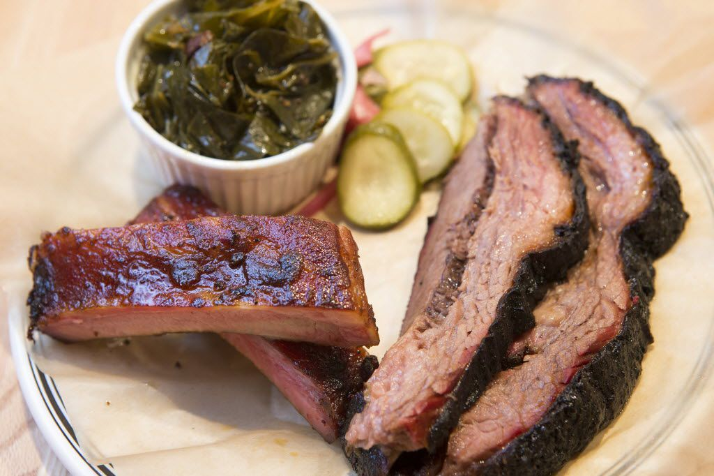 Pittmaster Matt Dallman and his wife Kimi Dallman teamed up with Dallas chef Scott Gottlich to open 18th and Vine BBQ, a jazzy spot specializing in Kansas City-style barbecue. Show is Dallman's combo plate with brisket, ribs and collard greens.