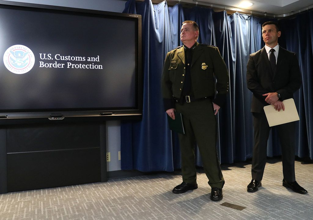 Brian Hastings,  chief of operations for the border patrol, left, and U.S. Customs and Border Protection Commissioner Kevin McAleenan prepare to brief the media on migration statistics on Tuesday in Washington, D.C. McAleenan also discussed new medical procedures and plans for a new central processing center in El Paso.