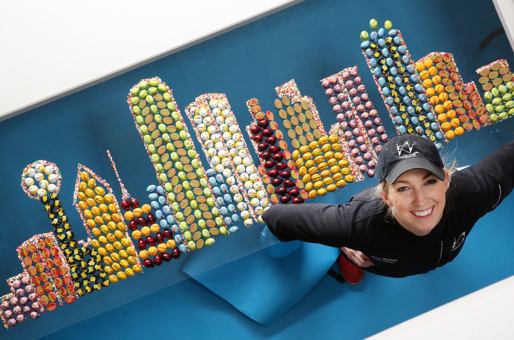 Kate Weiser, chocolatier, poses for a photograph next to her Dallas skyline made with her Kate Weiser Chocolates at The Dallas Morning News on Thursday, March 15, 2018. (Rose Baca/The Dallas Morning News)