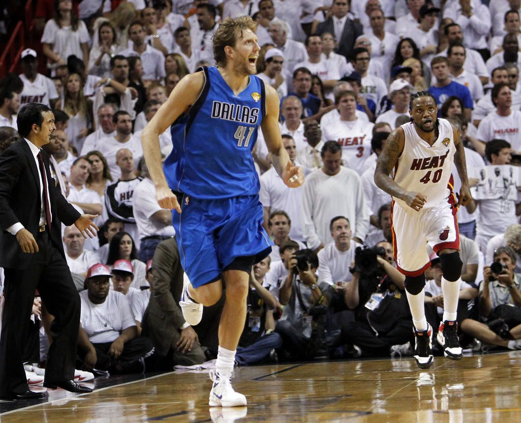 Dallas Mavericks power forward Dirk Nowitzki (41) reacts to hitting a three pointer against Miami Heat power forward Udonis Haslem (40) late in the fourth quarter of play in game six of the NBA Finals at American Airlines Arena Sunday, June 12, 2011 in Miami   (Tom Fox/The Dallas Morning News)
