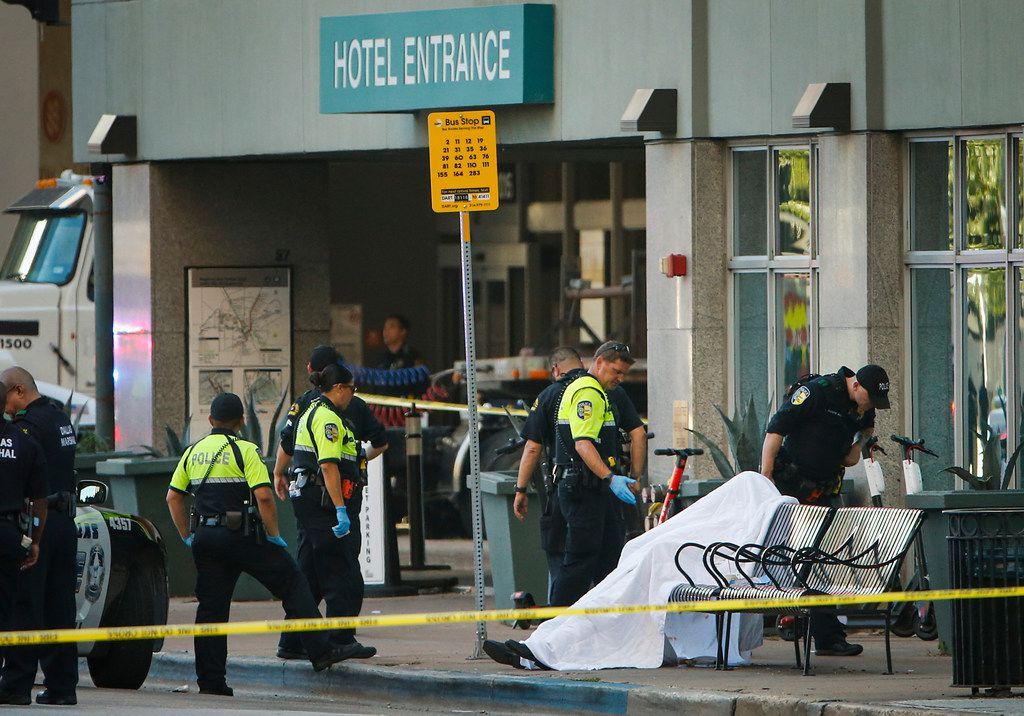 A deceased man's body was covered on a bus stop bench Friday outside the Homewood Suites on Elm Street in downtown Dallas. Johnny Roland Glover was a bystander who got caught in the crossfire of two groups.