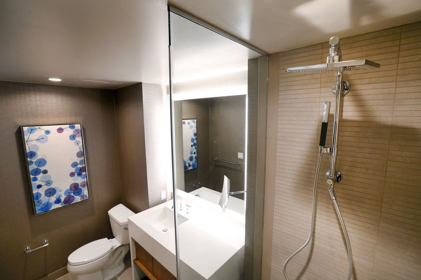 A bathroom and walk-in shower in a guest room in The Westin Irving Convention Center at Las Colinas.