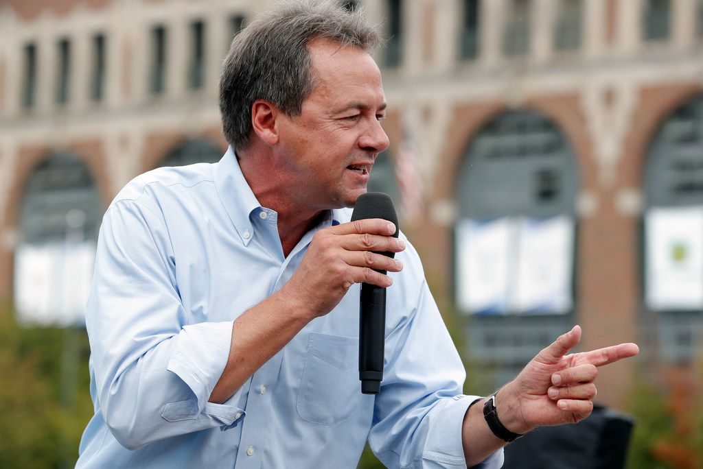 In this Aug. 16, 2018, photo, Montana Gov. Steve Bullock speaks at the Des Moines Register Soapbox during a visit to the Iowa State Fair in Des Moines -- a near mandatory stop for anyone running for president.
