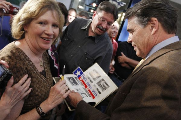 Becky Roe of Coal Valley, Iowa, showed Gov. Rick Perry a picture of himself as a high school sophomore in the 1966 Paint Creek School yearbook during an August stop in Iowa. Roe also once lived in Paint Creek.