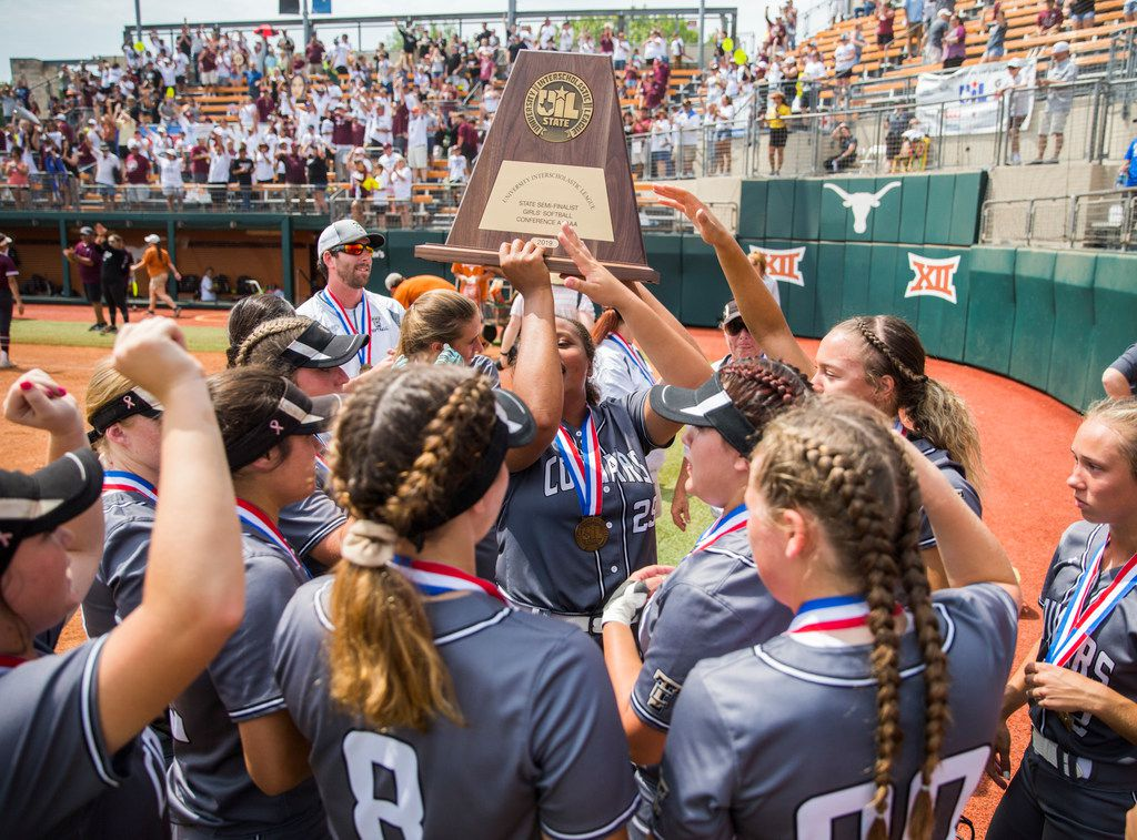 The Colony softball players hold up a state semifinalist trophy after they lost 5-1 in a UIL Class 5A state semifinal softball game between The Colony and Corpus Christi Calallen on Friday, May 31, 2019 at Red & Charline McCombs Field at the University of Texas in Austin. (Ashley Landis/The Dallas Morning News)