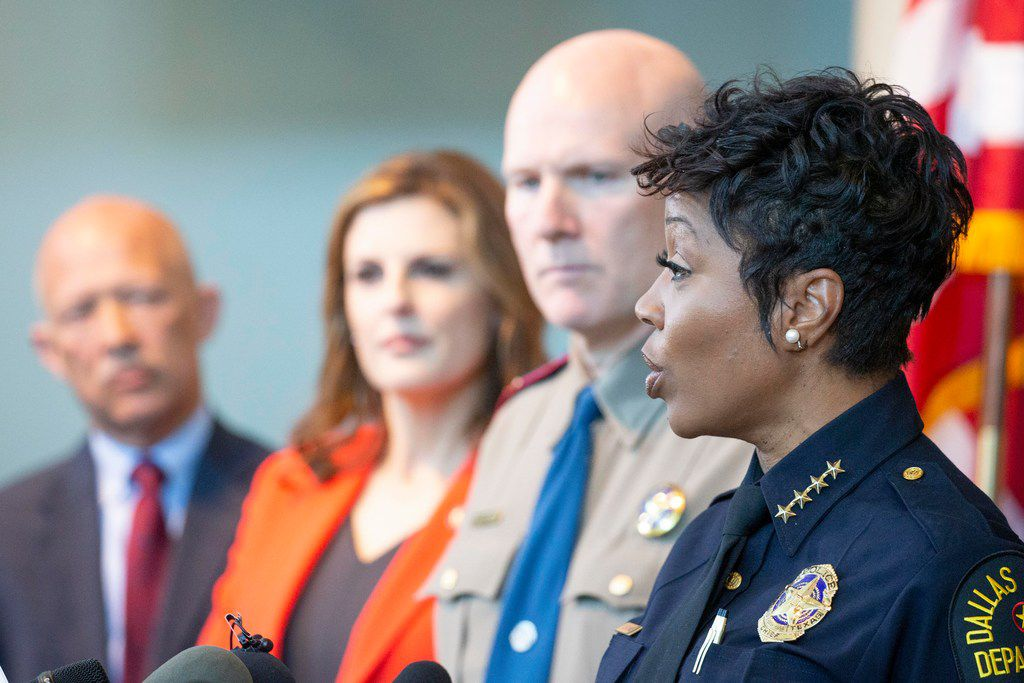 Dallas Police Chief U. Renee Hall gives remarks as Dallas County District Attorney John Creuzot (left) Erin Nealy Cox, U.S. Attorney for the Northern District of Texas, and Jeoff Williams, Regional Director of the Department of Public Safety, Region 1, listen during a press conference announcing a heightened enforcement efforts in targeted violent crime areas in the City of Dallas at the Jack Evans Headquarters on Friday in Dallas.
