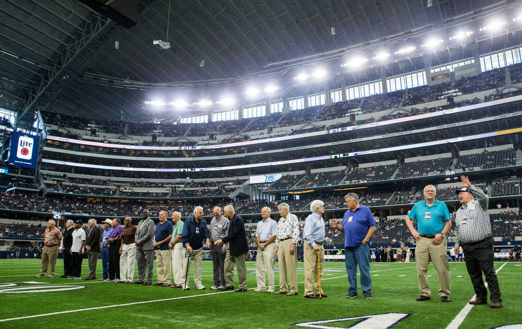 Former Dallas Cowboys players are honored on the field before an NFL football game between the Los Angeles Rams and the Dallas Cowboys on Sunday, October 1, 2017 at AT&T Stadium in Arlington, Texas. (Ashley Landis/The Dallas Morning News)