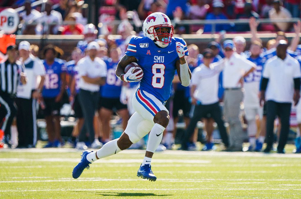 SMU wide receiver Reggie Roberson Jr. (8) races untouched to the end zone on a 75-yard touchdown pass from quarterback Shane Buechele during the first half of an NCAA football game against Temple at Ford Stadium on Saturday, Oct. 19, 2019, in Dallas.