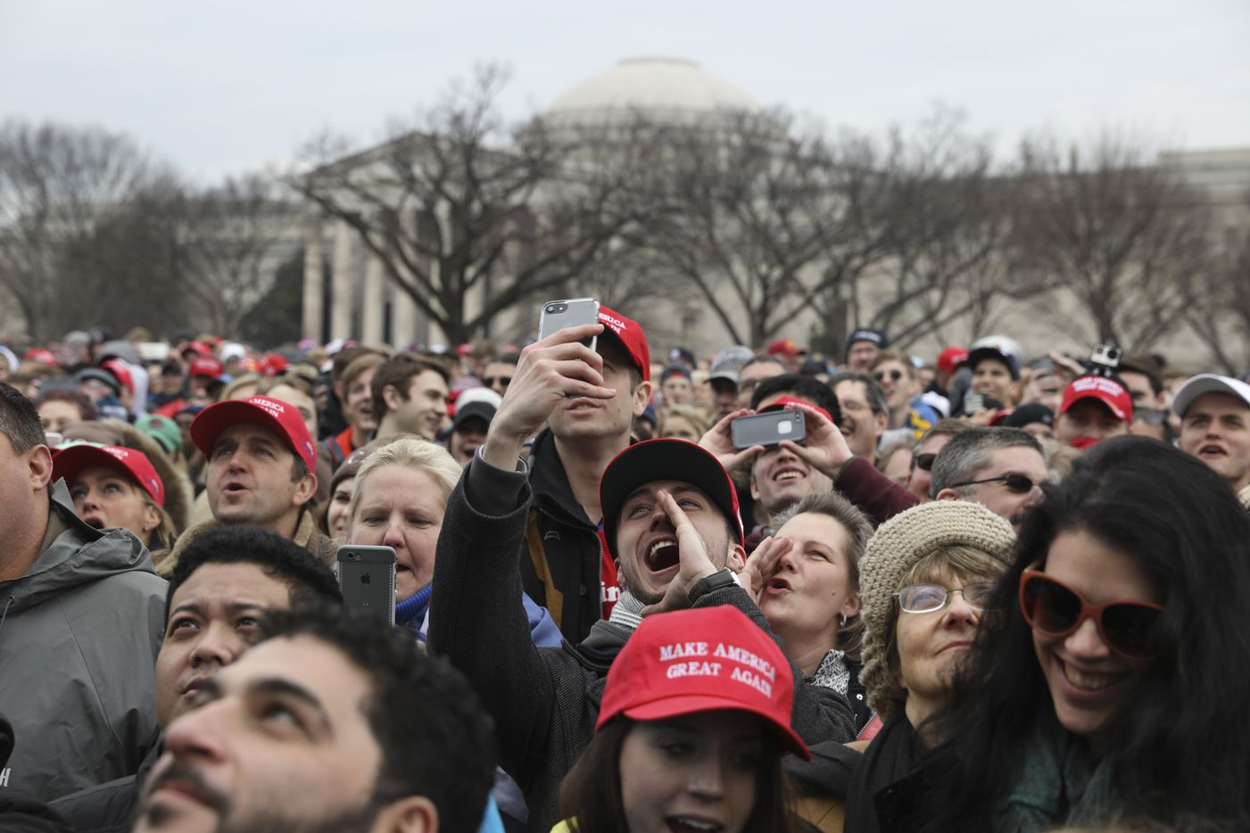 People gather on the National Mall for the inauguration of President Donald Trump at the U.S. Capitol in Washington, Jan. 20, 2017. (Todd Heisler/The New York Times)
