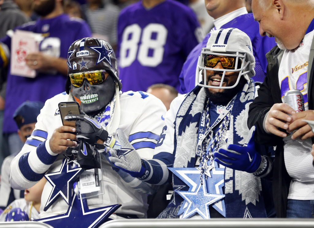 Dallas Cowboys text and visit with Minnesota Vikings fans during pregame wamups at U.S. Bank Stadium in Minneapolis, Minnesota, Thursday, December 1, 2016. (Tom Fox/The Dallas Morning News)
