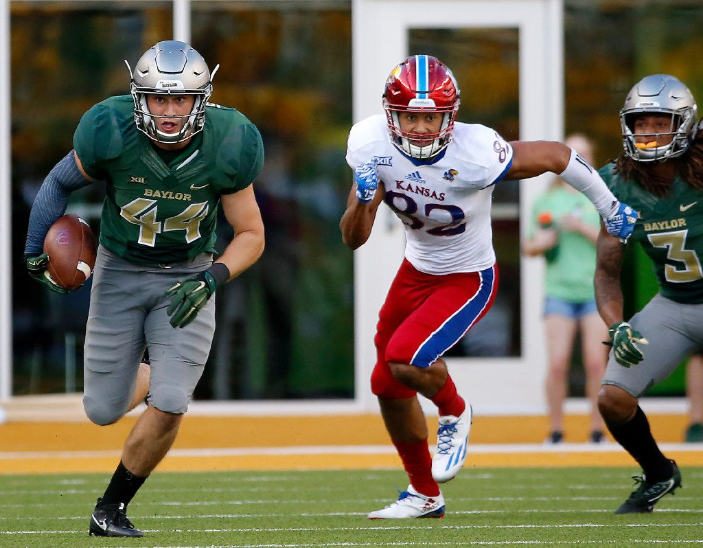Baylor linebacker Clay Johnston (44) returns an interception past Kansas wide receiver Shakiem Barbel (82) during the fourth quarter at McLane Stadium in Waco, Texas, Saturday, Oct. 15, 2016. Baylor won 49-7. (Jae S. Lee/The Dallas Morning News)