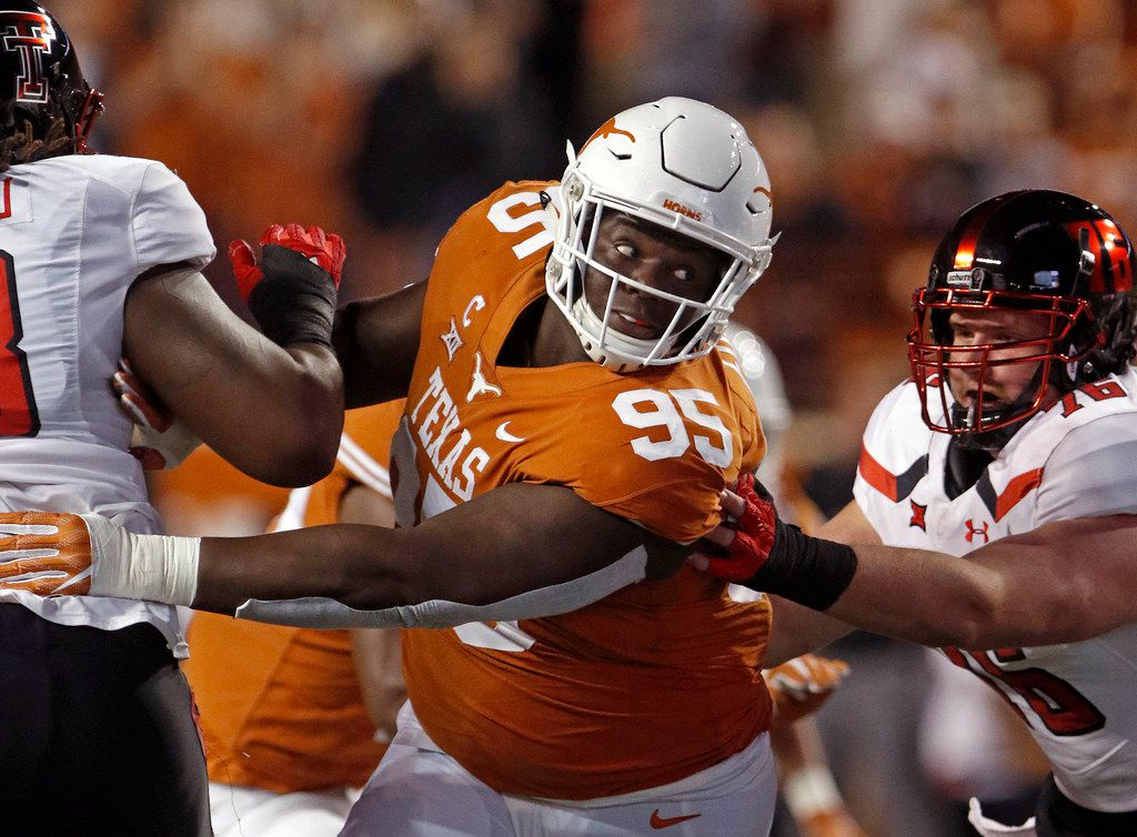 FILE - In this Nov. 24, 2017 file photo, Texas defensive lineman Poona Ford (95) rushes during the first half of an NCAA college football game against Texas Tech in Austin. (AP Photo/Michael Thomas, File)