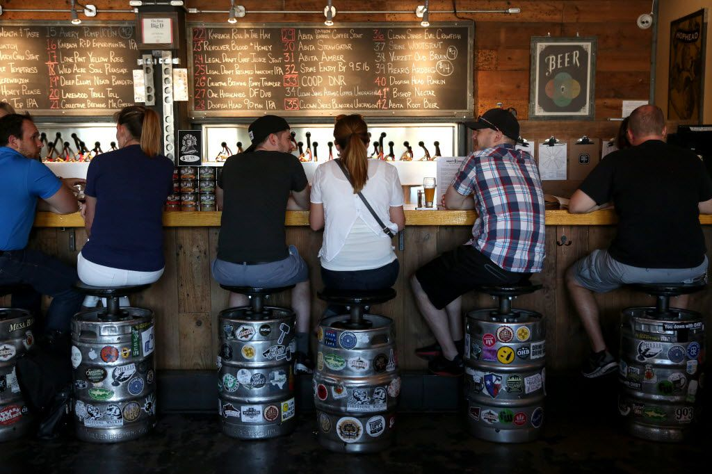 Patrons enjoy a beer at Craft and Growler in Dallas.