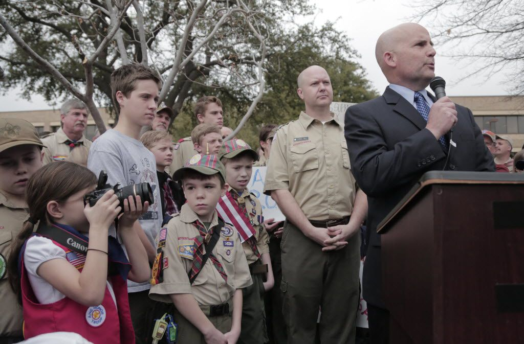 Collin County Judge Keith Self (right) and Collin County Commissioner Chris Hill (behind Self) spoke to supporters of the Boy Scouts' ban on gays as they  demonstrated and prayed outside the Boy Scouts of America headquarters in Irving in 2013.