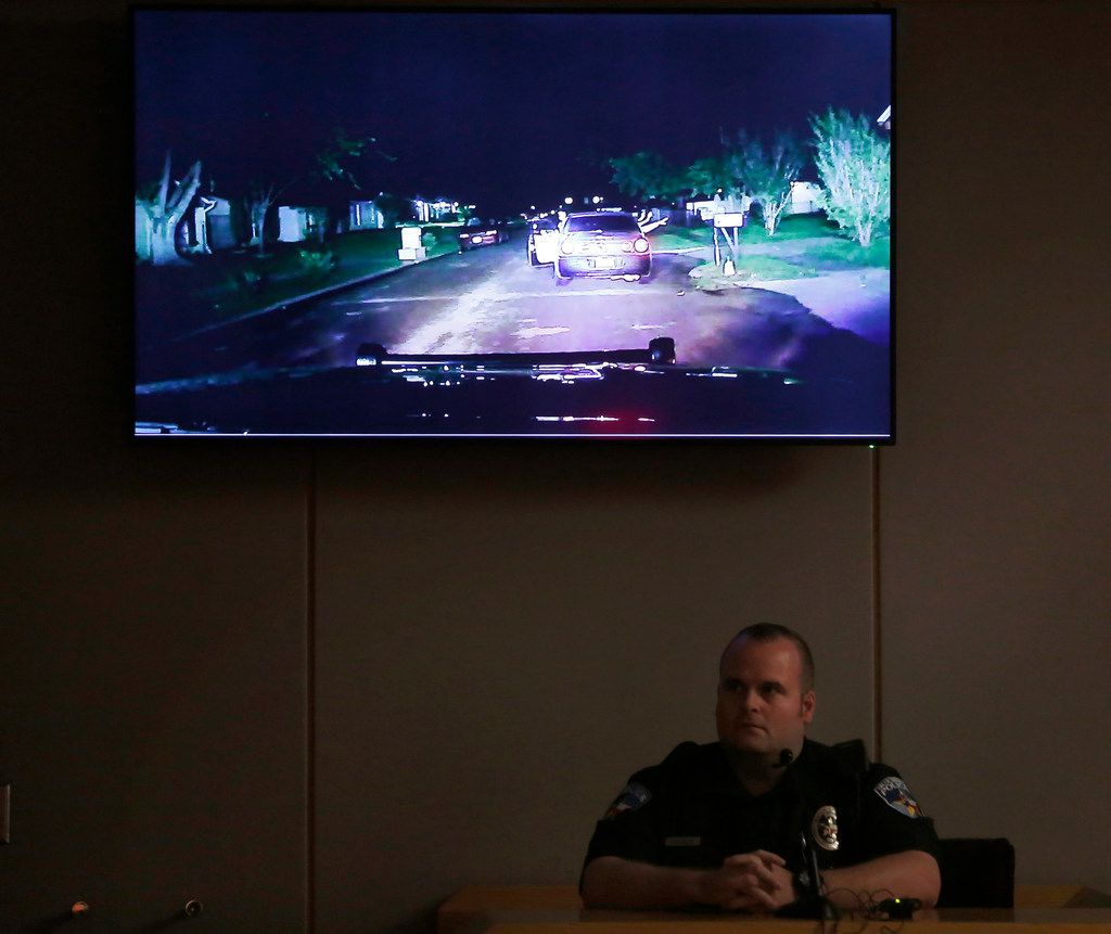 Balch Springs police Officer Jeremy Chamblee sits while the jury watches his dash-camera video during the third day of the trial of fired Balch Springs police Officer Roy Oliver, who is charged with murder in the death of 15-year-old Jordan Edwards.