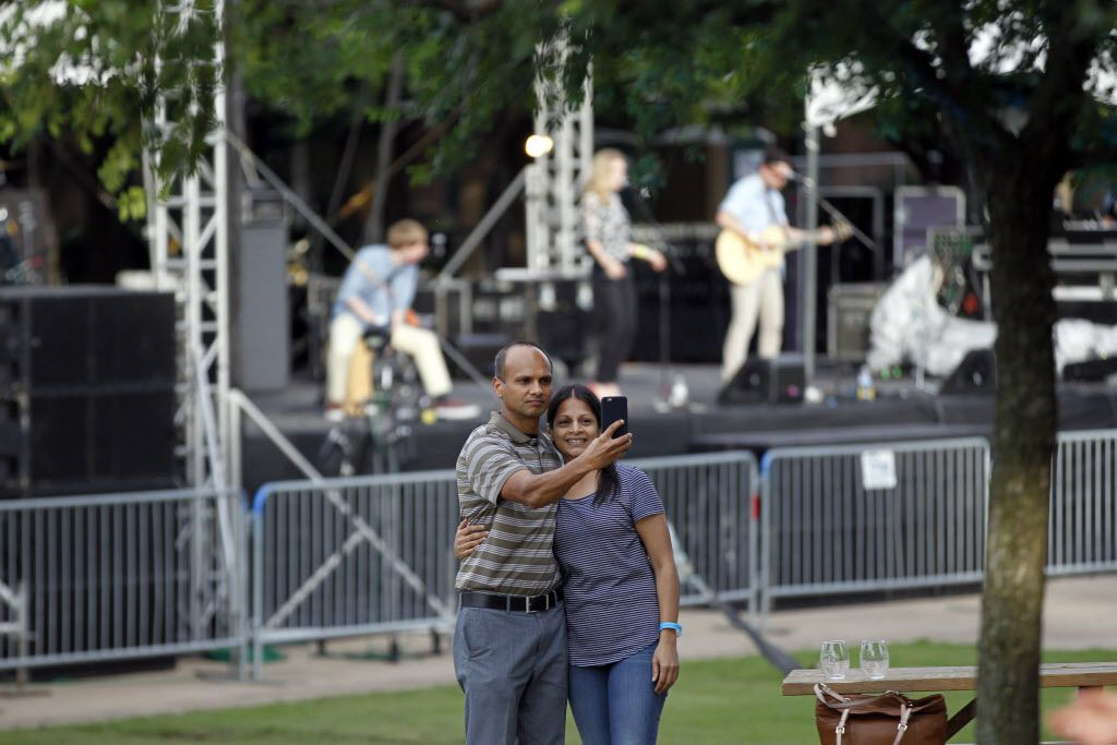 Raj Surpur takes a selfie with his wife Neeta Surpur during the Fork & Cork festival Addison Circle Park in Addison, TX on May 15, 2015.