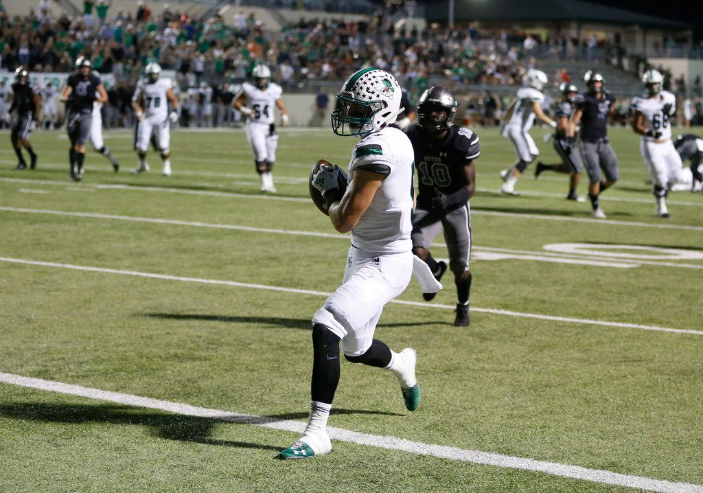 Southlake Carroll's Wills Meyer (5) scores a touchdown in front of Denton Guyer's Zion Settles (10) during the first half of play at C.H. Collins Complex in Denton, on Friday, October 4, 2019. (Vernon Bryant/The Dallas Morning News)