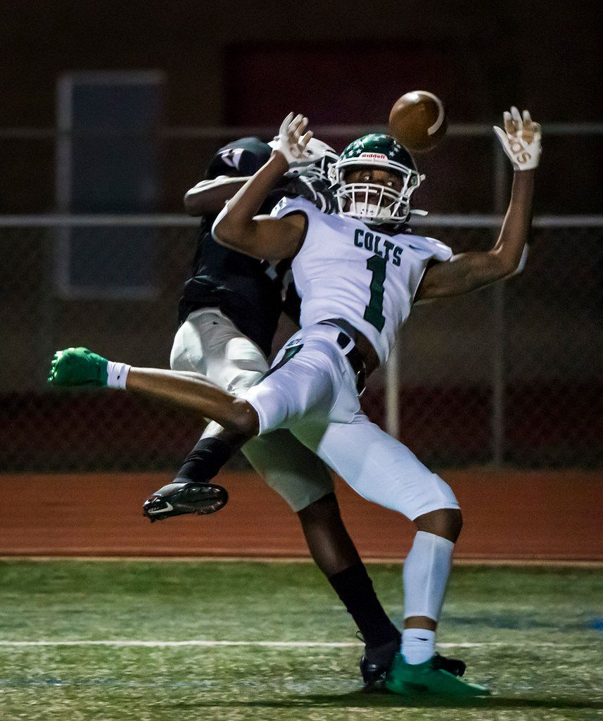 Arlington Bowie defensive back Jaylen Curvin (11) breaks up a pass intended for Arlington wide receiver Charles Brown (1) in the end zone during the first half of a high school football game at Wilemon Field on Friday, Oct. 11, 2019, in Arlington, Texas. (Smiley N. Pool/The Dallas Morning News)