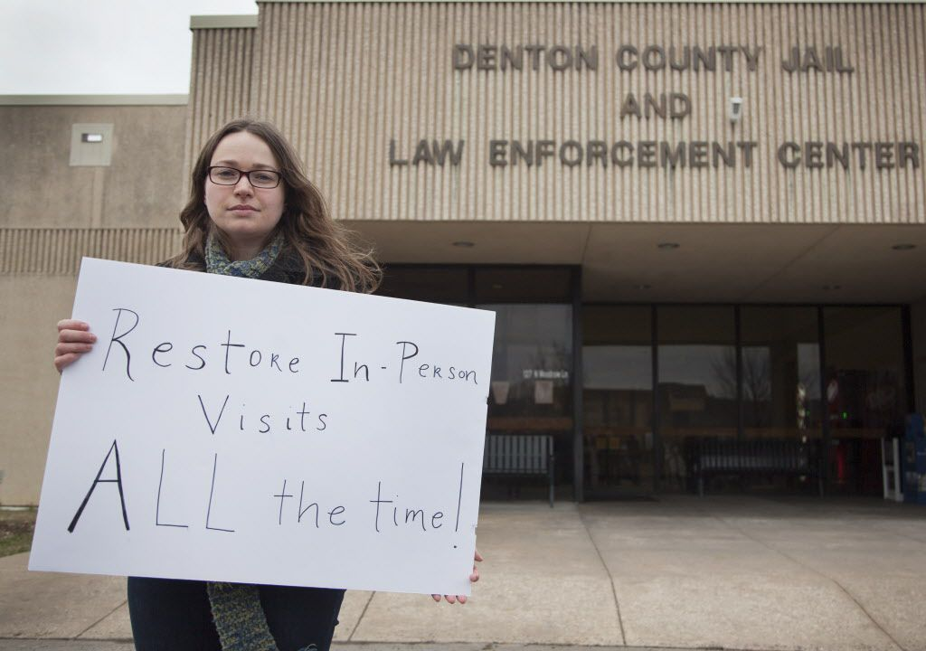 Jennifer Long poses in front of the Denton County Jail in February to protest the video visitation system the jail uses. (Kristen Watson/Denton Record-Chronicle)