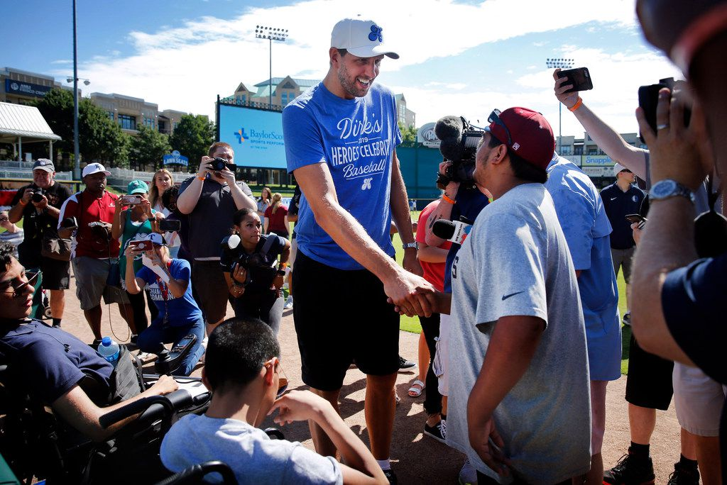 Thomas Jefferson High School special needs student Eric Villareal (right) meets Dallas Mavericks retired forward Dirk Nowitzki before batting practice.  Kids from the school came out to see their heroes in preparation for Friday's annual Dirk Nowitzki's Heroes Celebrity Baseball Game at the Dr Pepper Ballpark in Frisco, Texas, Thursday, June 6, 2019. Professional sports stars will participate in the game sponsored by Nowitizi and the Hero's Foundation program. (Tom Fox/The Dallas Morning News)