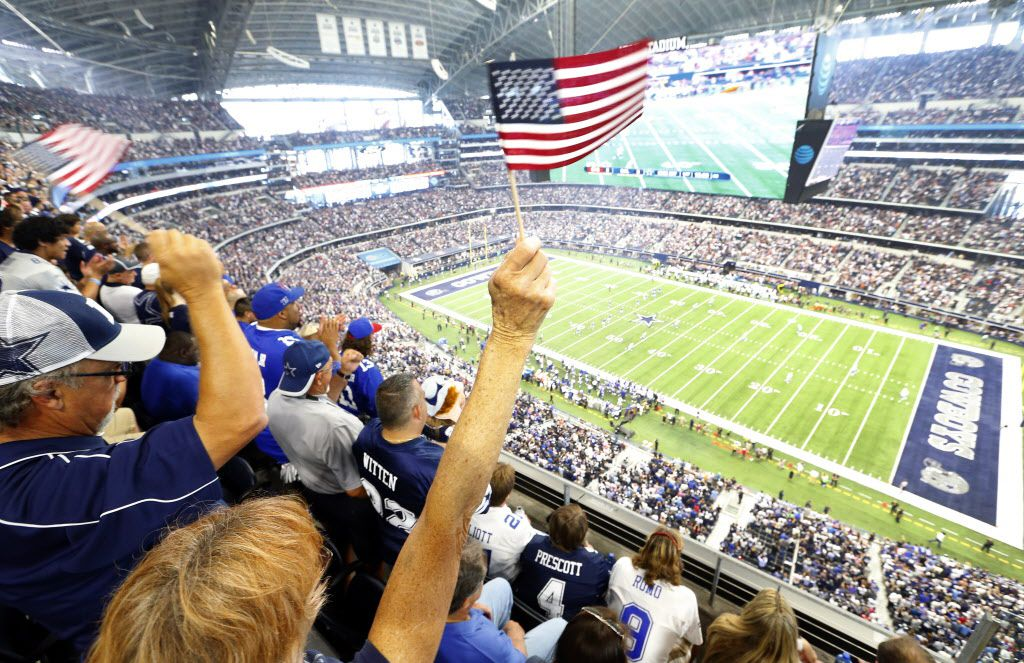 Dallas Cowboys fans waves their flags during the kickoff of the Cowboys season opener against the New York Giants at AT&T Stadium in Arlington, Texas, Sunday, September 11, 2016. (Tom Fox/The Dallas Morning News)