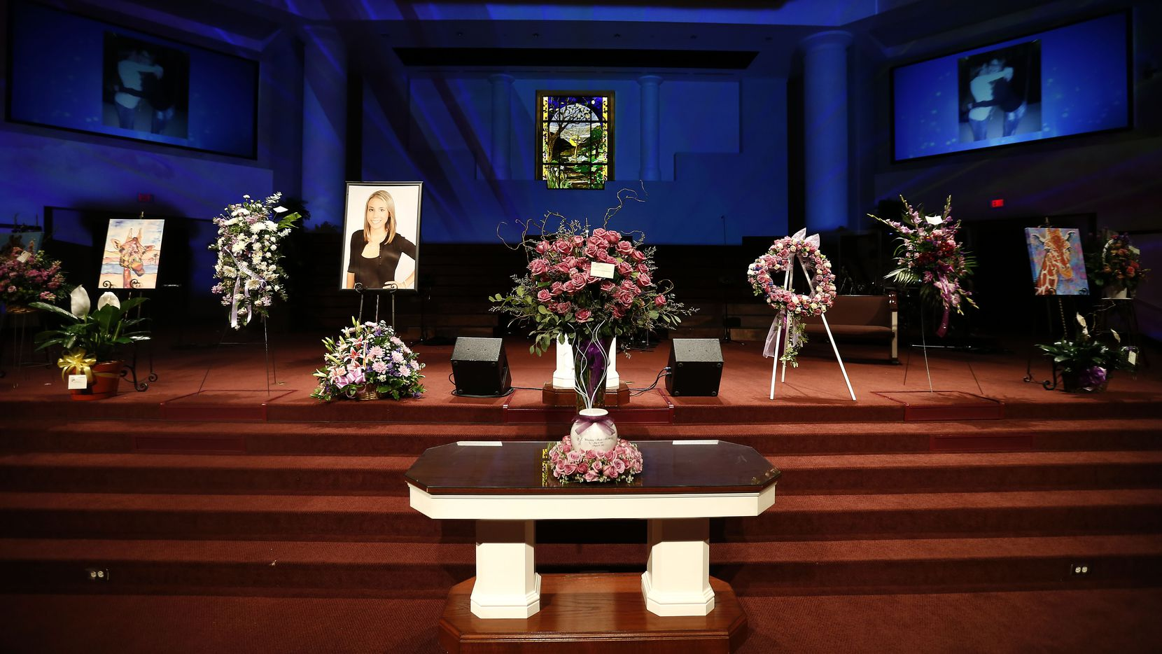 An urn containing Christina Morris' ashes, photos and flowers are seen during a memorial service at First Baptist Church in Allen on Saturday, April 21, 2018. (Jae S. Lee/The Dallas Morning News)