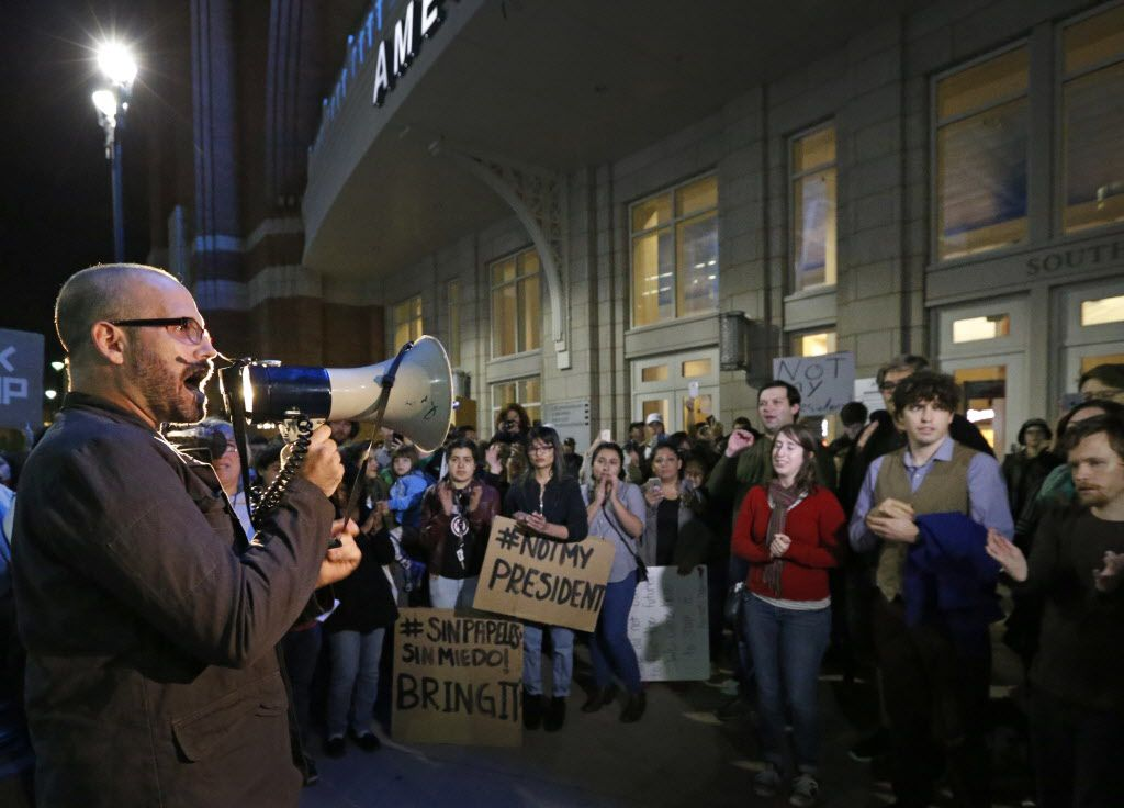 Daniel Cates uses a bullhorn to project his message during the Next Generation Action Network's  protest against a Trump presidency held outside the American Airlines Center in Dallas on Wednesday, November 9, 2016.