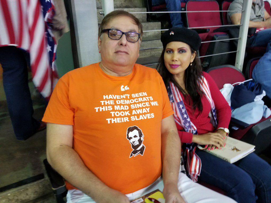 Armando and Telly Simon of San Antonio attend the Donald Trump-Ted Cruz rally in Houston at the Toyota Center on Oct. 22, 2018.