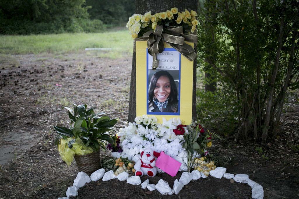 A memorial for Sandra Bland sits near where she was arrested in Prairie View, Texas in July 2015. Bland was found dead in a jail cell after her arrest during a traffic stop. Her family disputed the authorities' report that she had committed suicide and have reached a $1.9 million settlement in their wrongful death civil suit, according to the family's lawyer in September, 2016.