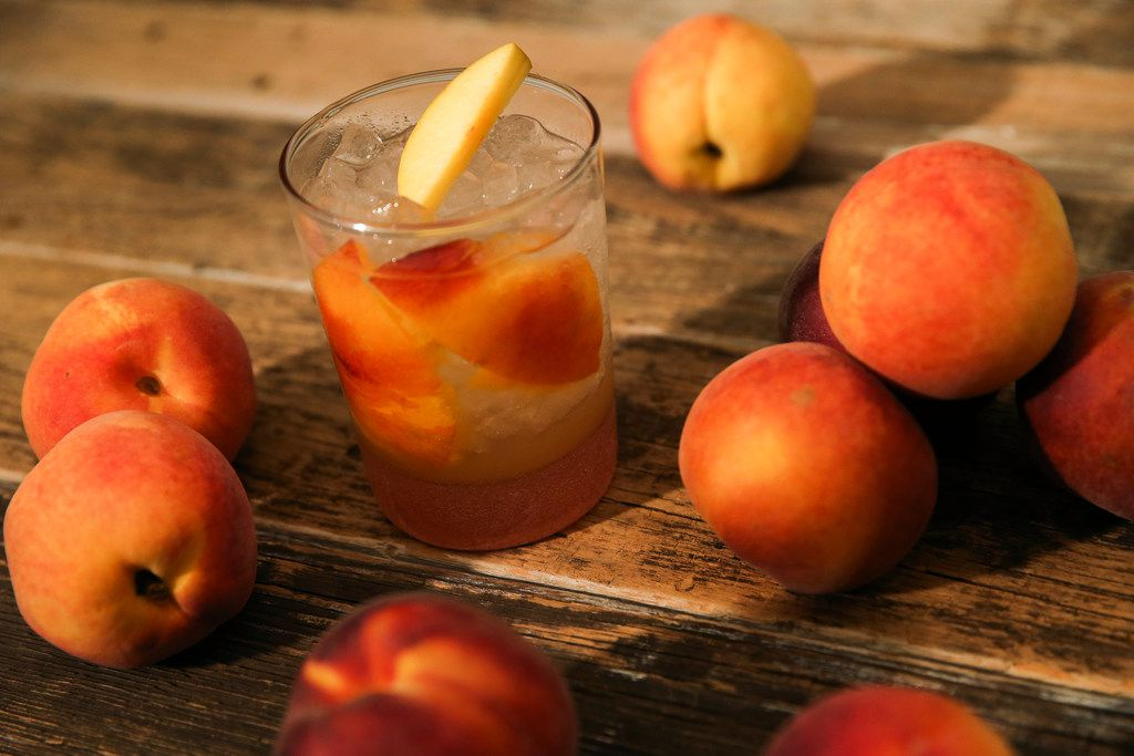 A peach cocktail with rum and ginger is seen Wednesday, July 10, 2019 in The Dallas Morning News Test Kitchen in Dallas.