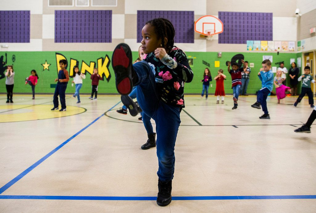 Zoe Campbell and other kindergarten students participate in a martial arts class at Pink Elementary in Frisco.