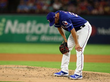 ARLINGTON, TEXAS - SEPTEMBER 14: Mike Minor #23 of the Texas Rangers reacts after giving up a single to Chad Pinder of the Oakland Athletics in the fourth inning at Globe Life Park in Arlington on September 14, 2019 in Arlington, Texas. (Photo by Richard Rodriguez/Getty Images)