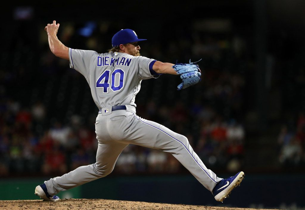 ARLINGTON, TEXAS - MAY 30:  Jake Diekman #40 of the Kansas City Royals throws against the Texas Rangers in the eighth inning at Globe Life Park in Arlington on May 30, 2019 in Arlington, Texas. (Photo by Ronald Martinez/Getty Images)
