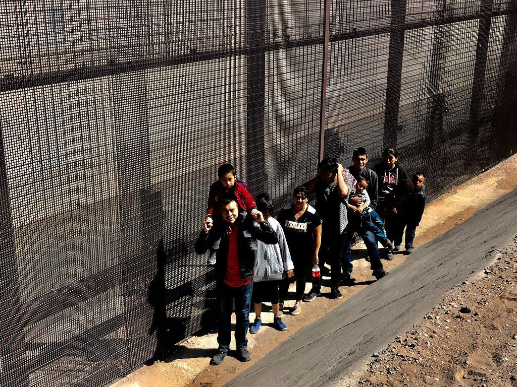 Migrants who crossed the border and turned themselves in to the border patrol were being held along the fence in an area known as El Paso's Lower Valley in the Ysleta area on March 6, 2019. They stand idle, anxious, on U.S. soil, in between the so-called wall and the Rio Grande, waiting for transportation. Many waited for hours.