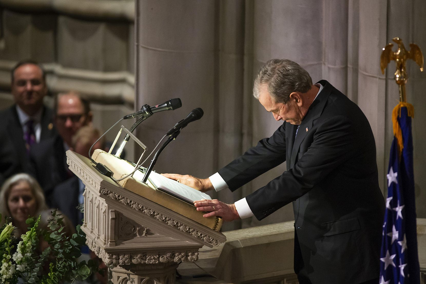 Former President George W. Bush composes himself as he delivers a eulogy during the State Funeral for his father George H.W. Bush, the 41st President of the United States, at the Washington National Cathedral on Wednesday, Dec. 5, 2018, in Washington. (Smiley N. Pool/The Dallas Morning News)