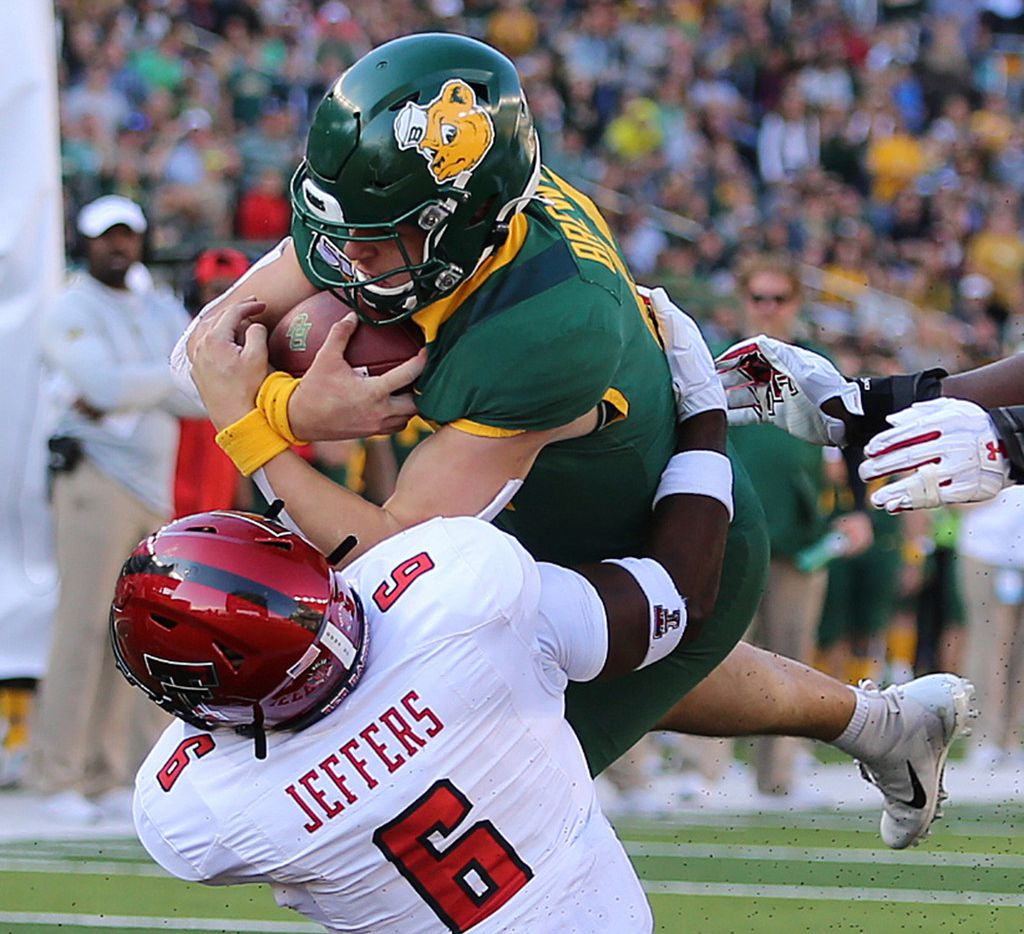 Baylor quarterback Charlie Brewer (12) dives for a touchdown through Texas Tech linebacker Riko Jeffers (6) during the second half of a NCAA college football game in Waco, Tex.,Saturday, Oct. 12, 2019.(AP Photo/Jerry Larson)