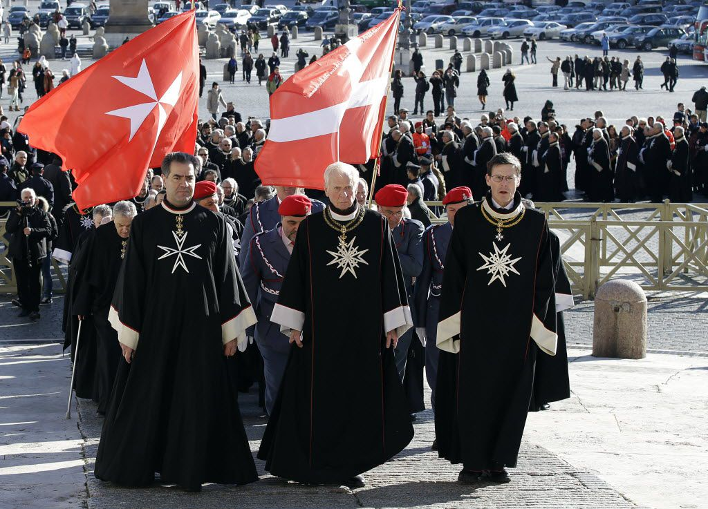 Members of the Knights of Malta walk in procession towards St. Peter's Basilica during a celebration to mark the 900th anniversary of the Order of the Knights of Malta, at the Vatican, Saturday, Feb. 9, 2013. (AP Photo/Gregorio Borgia)