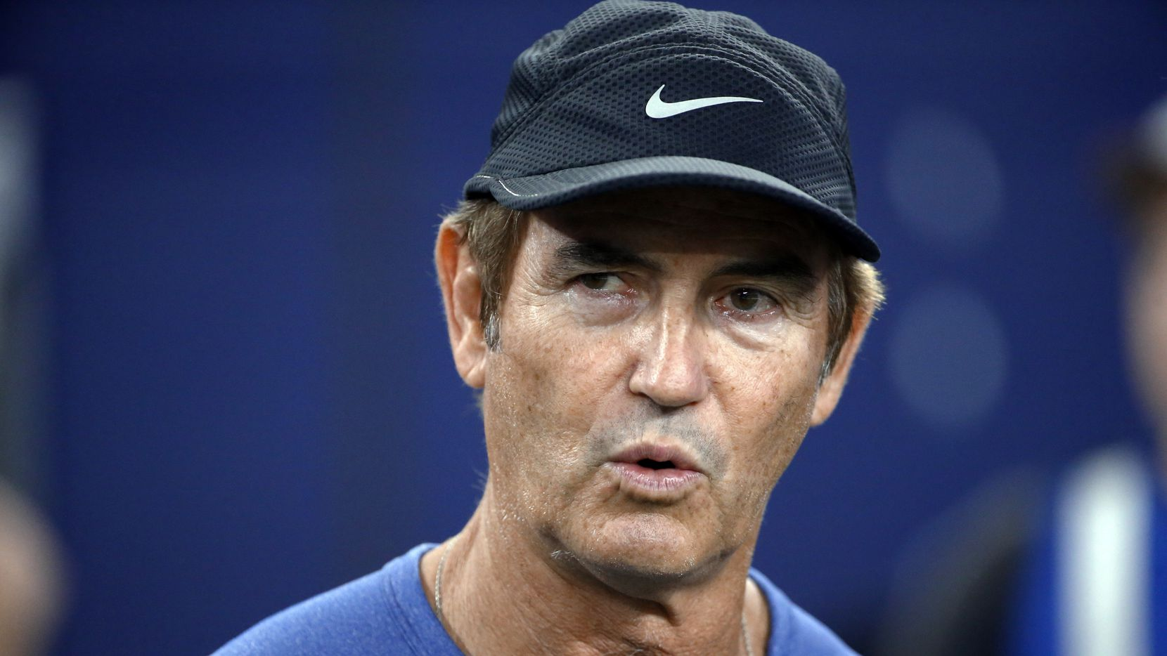Former Baylor football coach Art Briles watches the Dallas Cowboys and the Chicago Bears warm up for an NFL football game in Arlington, Texas. Houston athletic director Hunter Yurachek says former Baylor coach Art Briles is not a candidate to be the Cougars next coach.