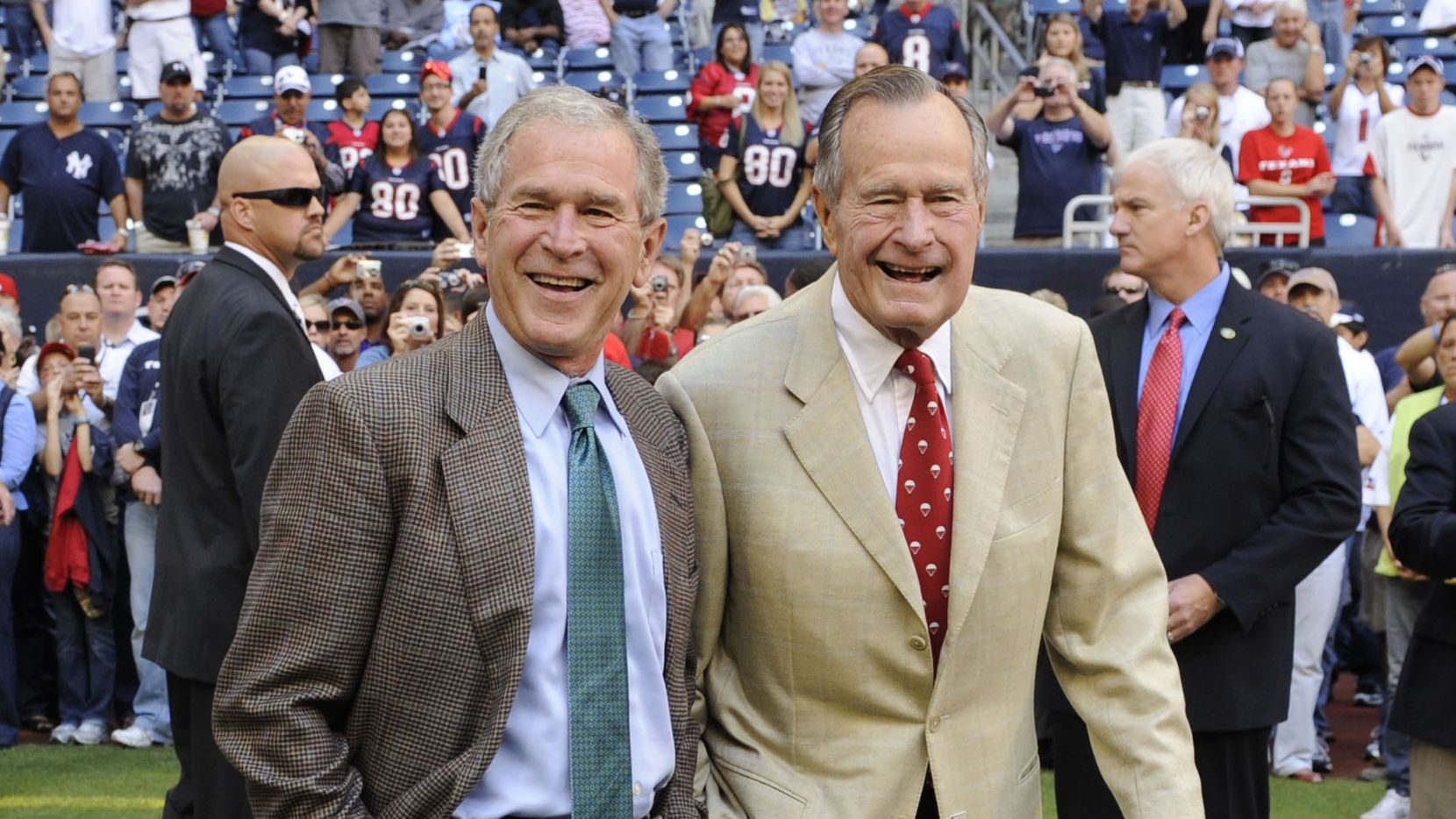 This Oct. 25, 2009 file photo shows former Presidents George H. W. Bush (right) and George W. Bush before a Houston Texans football game against the San Francisco 49ers.